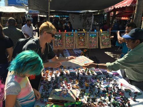 Purchasing local artwork at Tonala