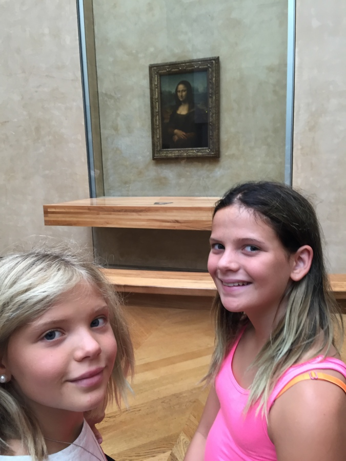 Posing with the Louvre's most prized asset
